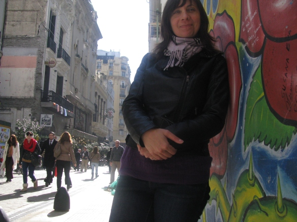 Michelle by the mural of Sandro